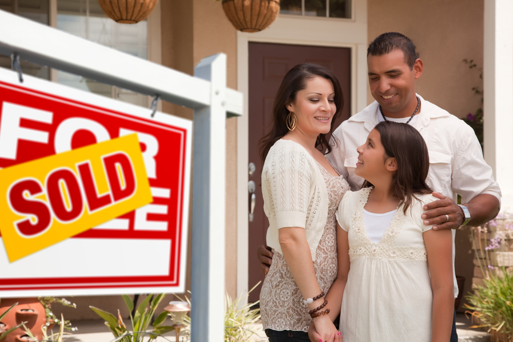 Hispanic Family in Front of Sold Home