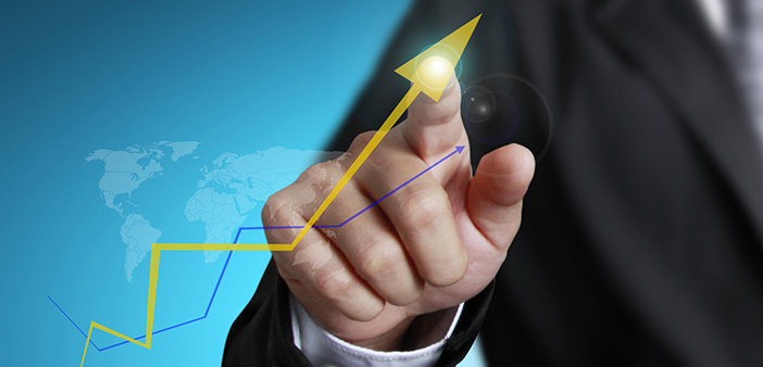 Business Man With Increased Profits Arrow